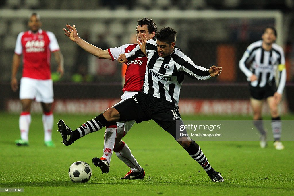 Dirk Marcellis of AZ and Everton of Heracles battle for the ball during the Dutch Cup semi final match between AZ Alkmaar and SC Heracles Almelo at...