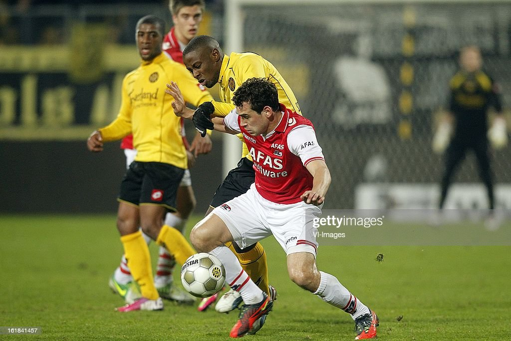 Dirk Marcellis of AZ (R), Arnaud Sutchuin Djoum of Roda JC (L) during the Dutch Eredivisie match between Roda JC Kerkrade and AZ Alkmaar at the Parkstad Limburg Stadium on february 16, 2013 in Kerkrade, The Netherlands