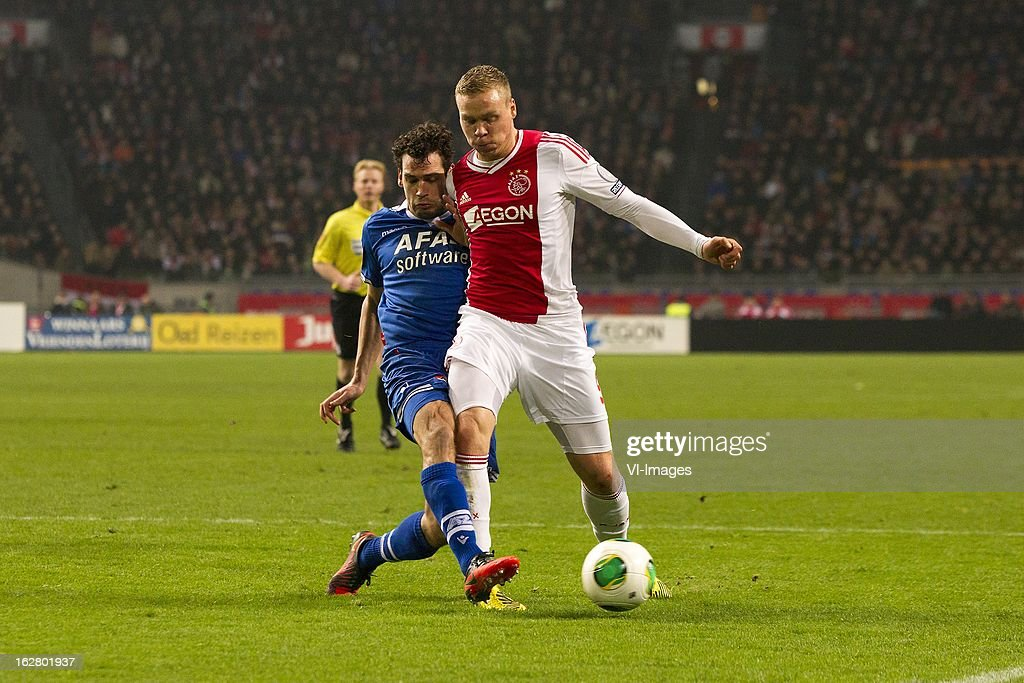 Dirk Marcellis of AZ, Kolbeinn Sigthorsson of Ajax during the Dutch Cup match between Ajax Amsterdam and AZ Alkmaar at the Amsterdam Arena on february 27, 2013 in Amsterdam, The Netherlands