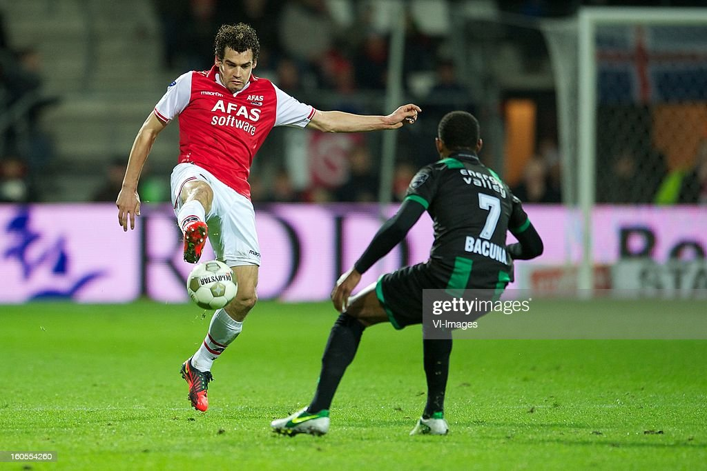 Dirk Marcellis of AZ, Leandro Bacuna of FC Groningen during the Dutch Eredivisie match between AZ Alkmaar and FC Groningen at the AFAS Stadium on february 2, 2013 in Alkmaar, The Netherlands
