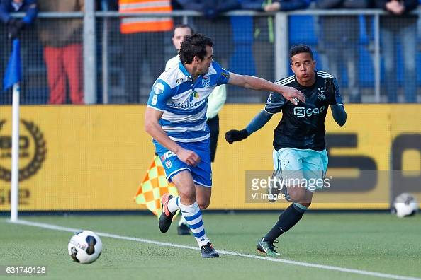Dirk Marcellis of PEC Zwolle Justin Kluivert of Ajaxduring the Dutch Eredivisie match between PEC Zwolle and Ajax Amsterdam at the MAC3Park stadium...
