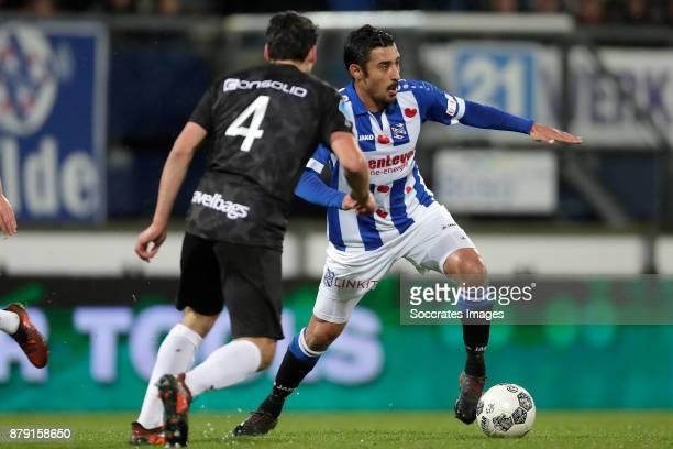 Dirk Marcellis of PEC Zwolle Reza Ghoochannejhad of SC Heerenveen during the Dutch Eredivisie match between SC Heerenveen v PEC Zwolle at the Abe...