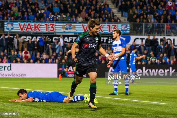 Dirk Marcellis of PEC Zwolle Ritsu Doan of FC Groningen during the Dutch Eredivisie match between PEC Zwolle and FC Groningen at the MAC3Park stadium...