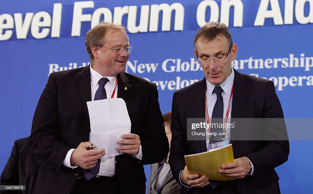 Dirk Niebel, Federal Minister for Economic Cooperation and Development of Germany and <a gi-track='captionPersonalityLinkClicked' href=/galleries/search?phrase=Andris+Piebalgs&family=editorial&specificpeople=536886 ng-click='$event.stopPropagation()'>Andris Piebalgs</a> EU Commissioner attend at the press conference during the 4th High Level Forum on Aid Effectiveness on November 30, 2011 in Busan, South Korea. The forum will be attended by over 2,500 members of the development assistance community with Secretary Clinton's visit to the forum marking the first time a U.S. Secretary of state has attended the discussions. This year's gathering will focus on fighting extreme poverty and improving gender equality.