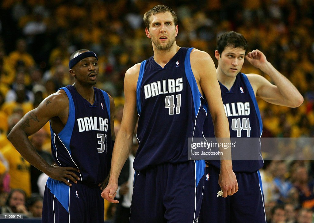 Dirk Nowitizki Jason Terry and Austin Croshere of the Dallas Mavericks look on against the Golden State Warriors in Game 6 of the Western Conference...