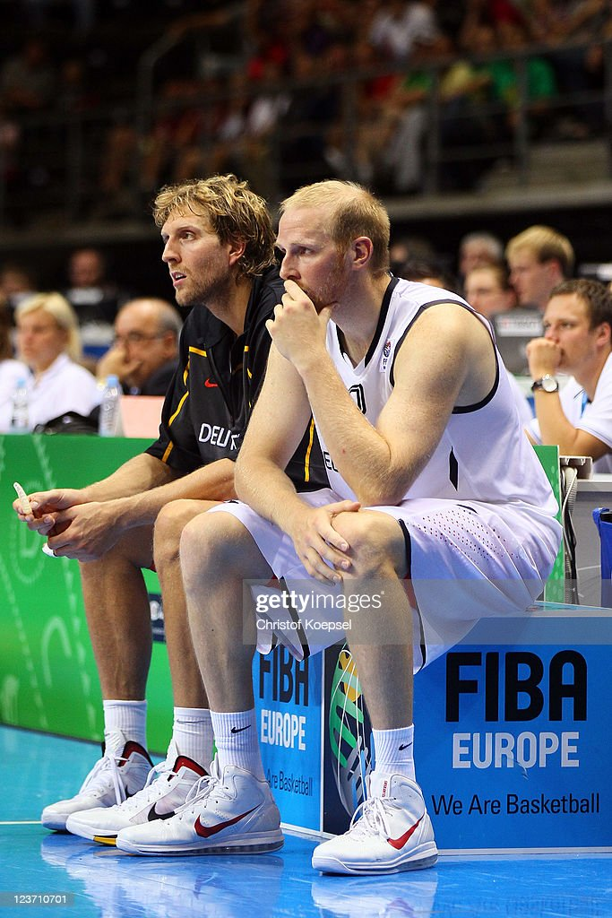 Dirk Nowitzki and Chris Kaman of Germany look dejected during the EuroBasket 2011 first round group B match between Germany and Serbia at Siauliai Arena on September 4, 2011 in Siauliai, Lithuania.
