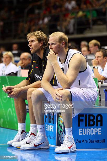 Dirk Nowitzki and Chris Kaman of Germany look dejected during the EuroBasket 2011 first round group B match between Germany and Serbia at Siauliai...