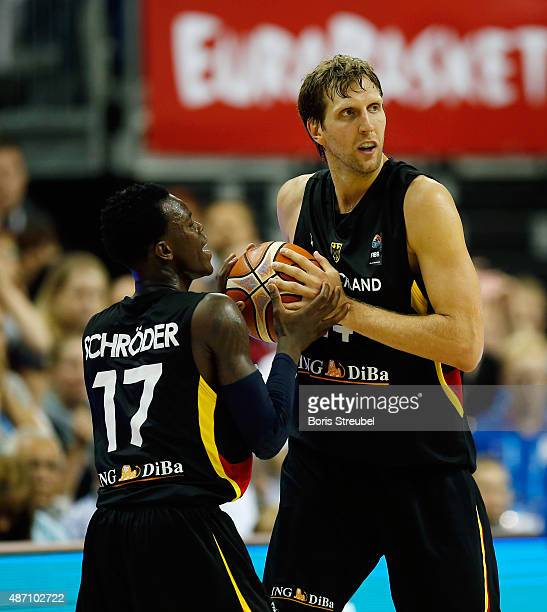 Dirk Nowitzki and Dennis Schroeder of Germany during the FIBA EuroBasket 2015 Group B basketball match between Serbia and Germany at Arena of...