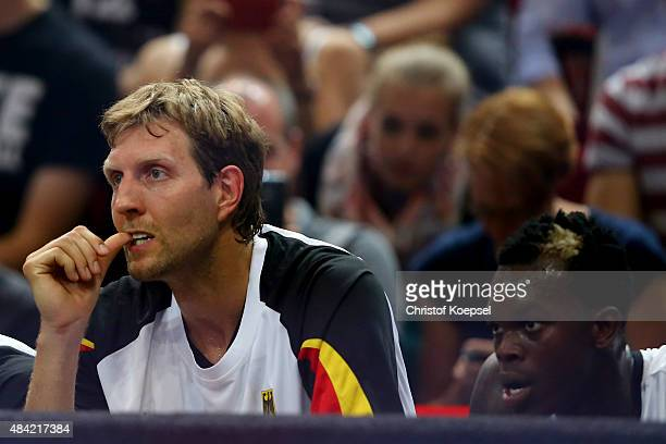 Dirk Nowitzki and Dennis Schroeder of Germany sit on the bench during the men's Basketball friendly match between Germany and Croatia at OEVBArena on...