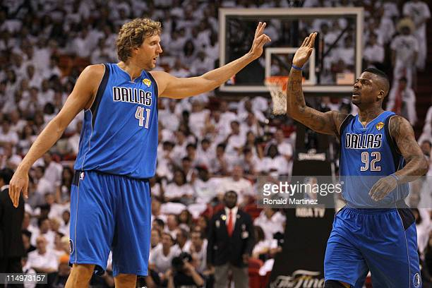 Dirk Nowitzki and DeShawn Stevenson of the Dallas Mavericks celebrate after Stevenson made a 3point shot in the third quarter against the Miami Heat...