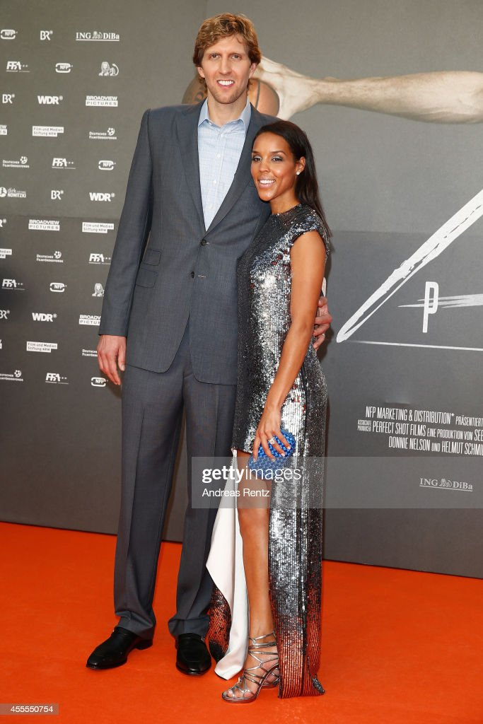 <a gi-track='captionPersonalityLinkClicked' href=/galleries/search?phrase=Dirk+Nowitzki&family=editorial&specificpeople=201490 ng-click='$event.stopPropagation()'>Dirk Nowitzki</a> and his wife <a gi-track='captionPersonalityLinkClicked' href=/galleries/search?phrase=Jessica+Nowitzki&family=editorial&specificpeople=10930728 ng-click='$event.stopPropagation()'>Jessica Nowitzki</a> attend the premiere of the film 'Nowitzki. Der Perfekte Wurf' at Cinedom on September 16, 2014 in Cologne, Germany.