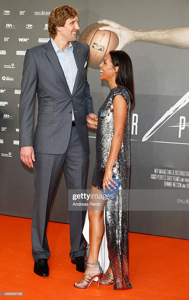 Dirk Nowitzki and his wife Jessica Nowitzki attend the premiere of the film 'Nowitzki. Der Perfekte Wurf' at Cinedom on September 16, 2014 in Cologne, Germany.