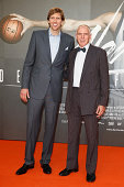 Dirk Nowitzki and Holger Geschwindner attends the premiere of the film 'Nowitzki Der Perfekte Wurf' at Cinedom on September 16 2014 in Cologne Germany