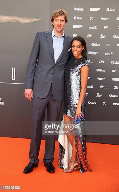 Dirk Nowitzki and Jessica Nowitzki attend the premiere of the film 'Nowitzki Der Perfekte Wurf' at Cinedom on September 16 2014 in Cologne Germany