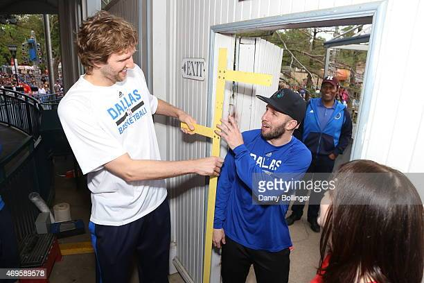 Dirk Nowitzki and JJ Barea of the Dallas Mavericks attend a season ticket holders fan appreciation event on April 6 2015 at Six Flags Over Texas in...