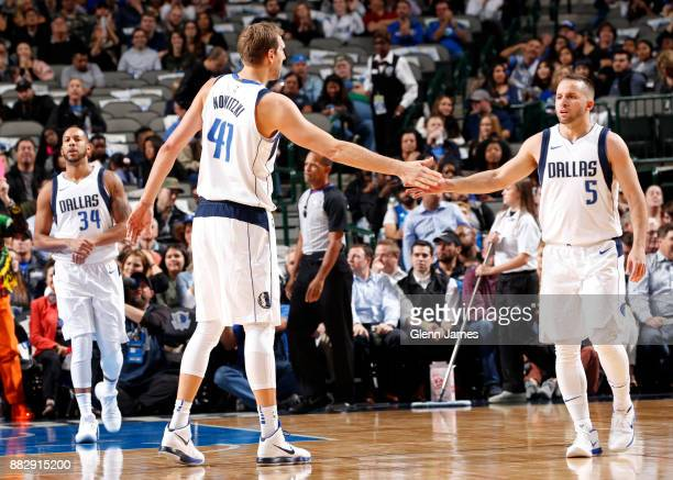 Dirk Nowitzki and JJ Barea of the Dallas Mavericks shake hands against the Brooklyn Nets on November 29 2017 at the American Airlines Center in...