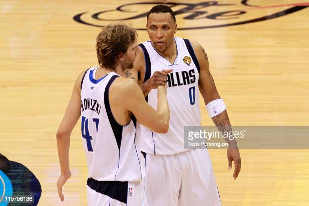 Dirk Nowitzki and Shawn Marion of the Dallas Mavericks celebrate their 112103 win against the Miami Heat in Game Five of the 2011 NBA Finals at...
