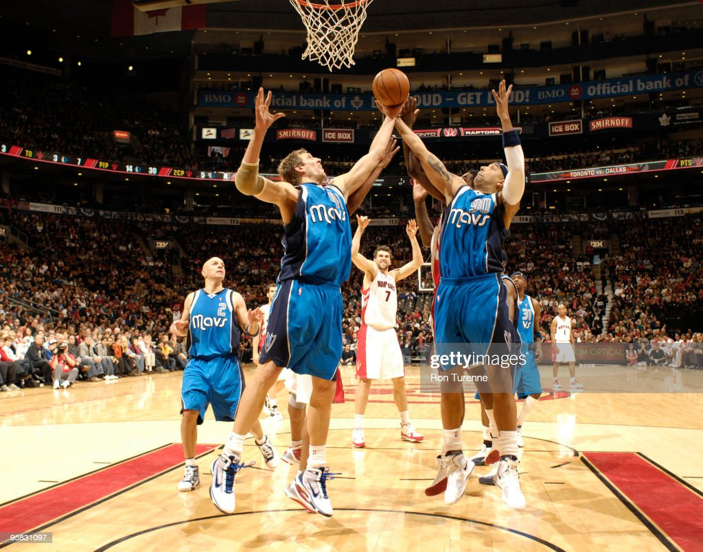 Dirk Nowitzki #41 and teammate Drew Gooden #90 of the Dallas Mavericks go up for the rebound during a game against the Toronto Raptors on January 17, 2010 at the Air Canada Centre in Toronto, Ontario, Canada.