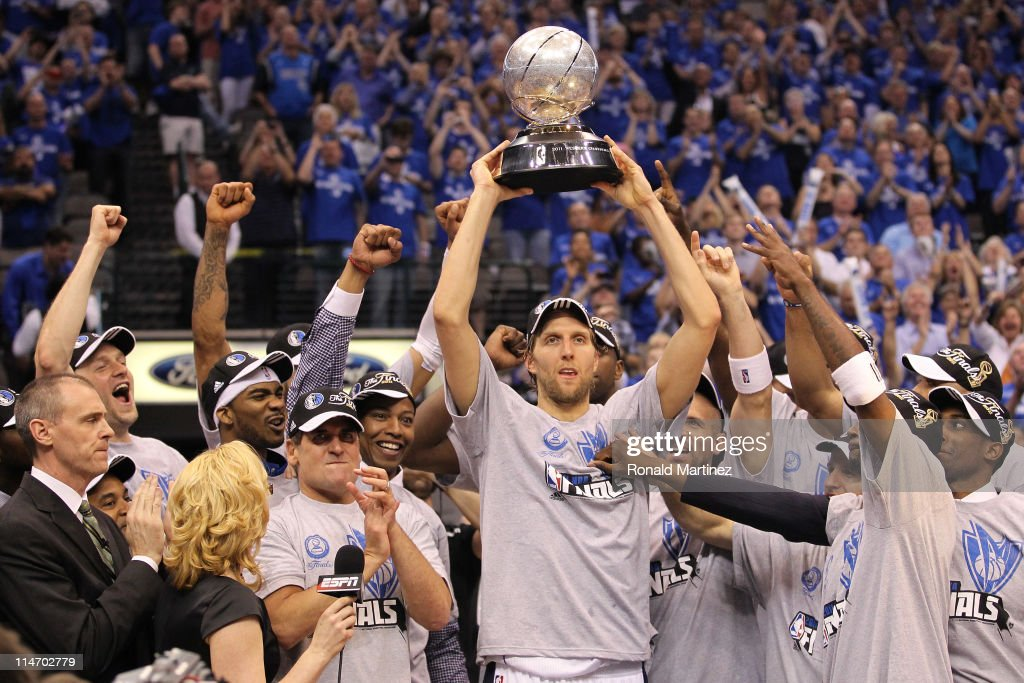 Dirk Nowitzki and the Dallas Mavericks celebrate their 10096 victory against the Oklahoma City Thunder in Game Five of the Western Conference Finals...