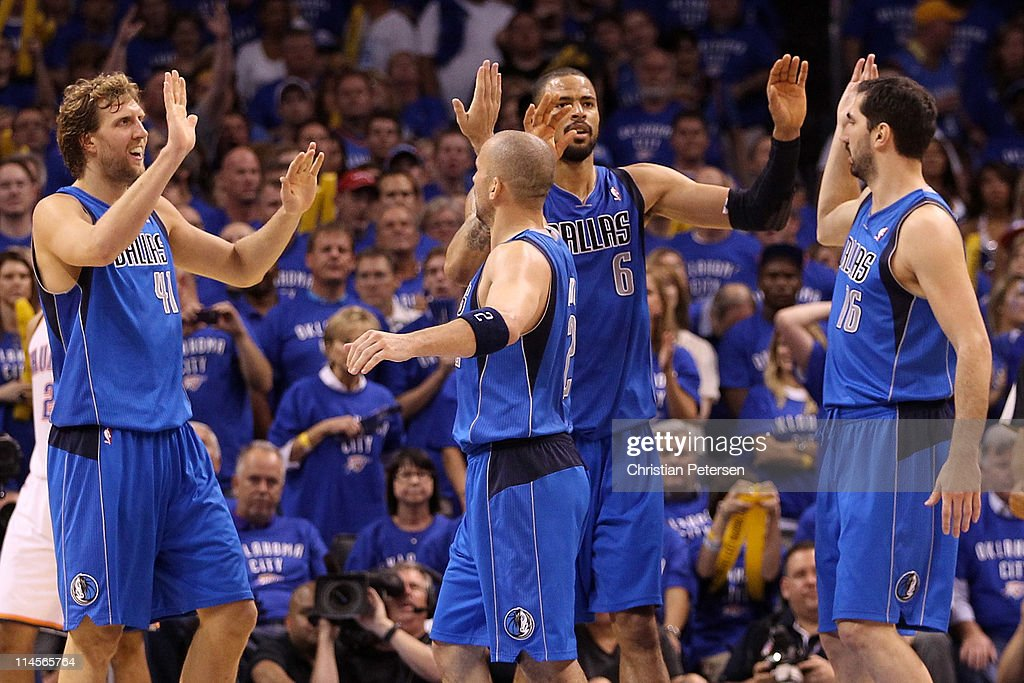 Dirk Nowitzki #41, Jason Kidd #2, Tyson Chandler #6 and Peja Stojakovic #16 of the Dallas Mavericks react in the fourth quarter while taking on the Oklahoma City Thunder in Game Four of the Western Conference Finals during the 2011 NBA Playoffs at Oklahoma City Arena on May 23, 2011 in Oklahoma City, Oklahoma.