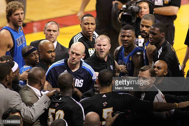 Dirk Nowitzki Jason Terry Brian Cardinal and DeShawn Stevenson of the Dallas Mavericks confront players from the Miami Heat on the court in the...
