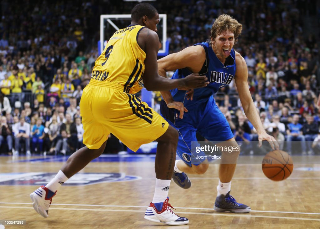 <a gi-track='captionPersonalityLinkClicked' href=/galleries/search?phrase=Dirk+Nowitzki&family=editorial&specificpeople=201490 ng-click='$event.stopPropagation()'>Dirk Nowitzki</a> (R) of Dallas is challenged by <a gi-track='captionPersonalityLinkClicked' href=/galleries/search?phrase=Deon+Thompson&family=editorial&specificpeople=4026290 ng-click='$event.stopPropagation()'>Deon Thompson</a> of Berlin during the NBA Europe Live 2012 Tour match between Alba Berlin and Dallas Mavericks at O2 World on October 6, 2012 in Berlin, Germany.