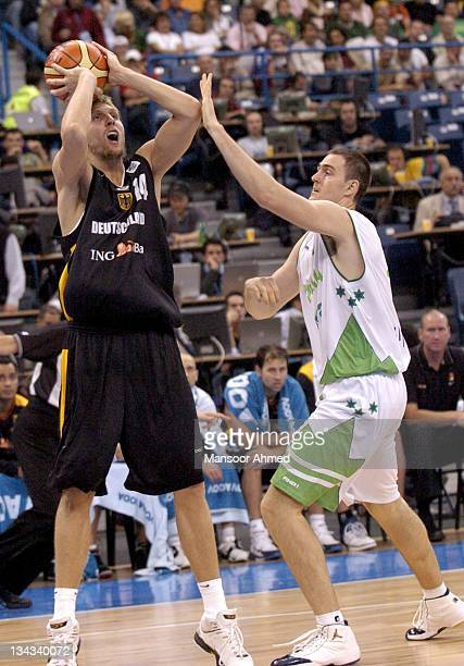 Dirk Nowitzki of Germany and Erazem Lorbek in action during the quarter final game at the 2005 European Basketball Championships in Belgrade Serbia...