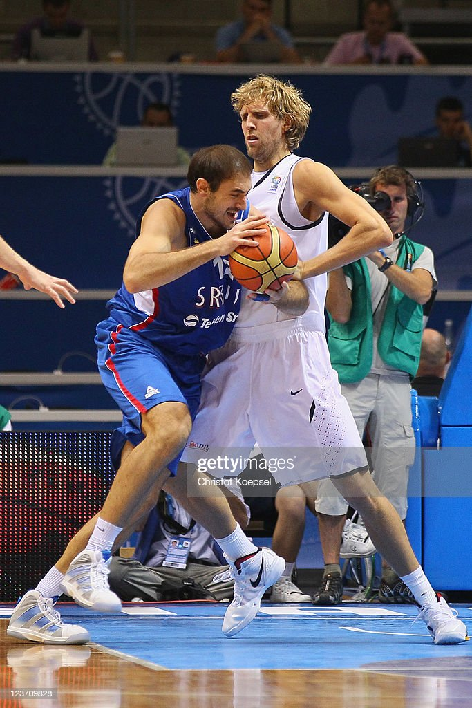 <a gi-track='captionPersonalityLinkClicked' href=/galleries/search?phrase=Dirk+Nowitzki&family=editorial&specificpeople=201490 ng-click='$event.stopPropagation()'>Dirk Nowitzki</a> of Germany (R) defends against <a gi-track='captionPersonalityLinkClicked' href=/galleries/search?phrase=Nenad+Krstic&family=editorial&specificpeople=202625 ng-click='$event.stopPropagation()'>Nenad Krstic</a> of Serbia during the EuroBasket 2011 first round group B match between Germany and Serbia at Siauliai Arena on September 4, 2011 in Siauliai, Lithuania.