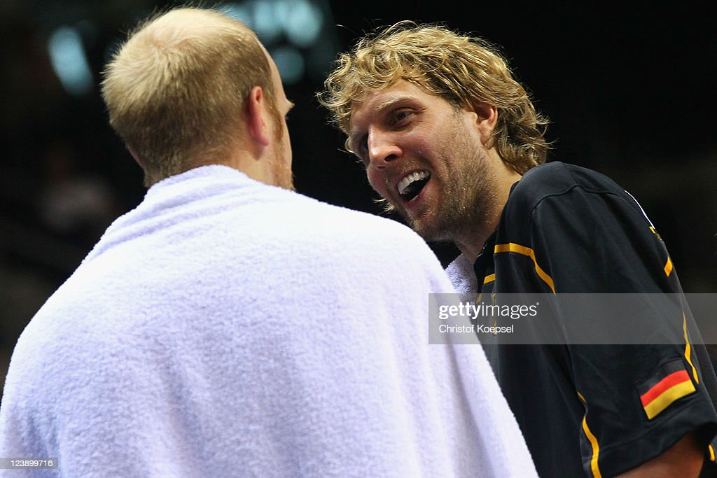 <a gi-track='captionPersonalityLinkClicked' href=/galleries/search?phrase=Dirk+Nowitzki&family=editorial&specificpeople=201490 ng-click='$event.stopPropagation()'>Dirk Nowitzki</a> of Germany (R) smiles at <a gi-track='captionPersonalityLinkClicked' href=/galleries/search?phrase=Chris+Kaman&family=editorial&specificpeople=201661 ng-click='$event.stopPropagation()'>Chris Kaman</a> of Germany during the EuroBasket 2011 first round group B match between Latvia and Germany at Siauliai Arena on September 5, 2011 in Siauliai, Lithuania.