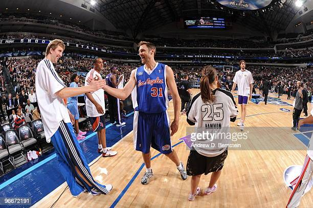 Dirk Nowitzki of Team Texas is congratulated by Brent Barry of Team Los Angeles during the 2010 Haier Shooting Stars on February 13 2010 at the...