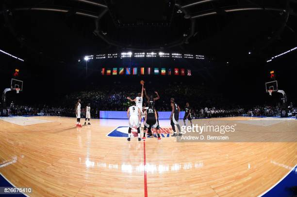 Dirk Nowitzki of Team World goes for the tip off against Clint Capela of Team Africa in the 2017 Africa Game as part of the Basketball Without...