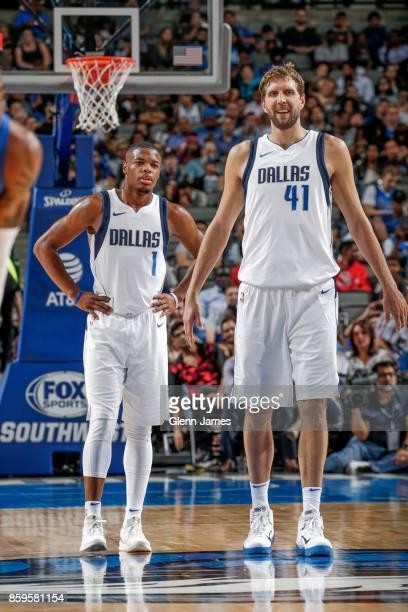 Dirk Nowitzki of the Dallas Mavericks and Dennis Smith Jr #1 of the Dallas Mavericks look on during a preseason game against the Orlando Magic on...