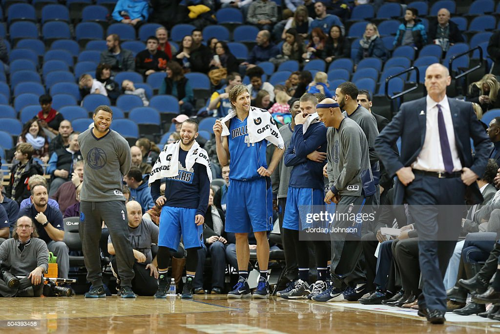 Dirk Nowitzki #41 of the Dallas Mavericks and his teammates react to a play during the game against the Minnesota Timberwolves on January 10, 2016 at Target Center in Minneapolis, Minnesota.