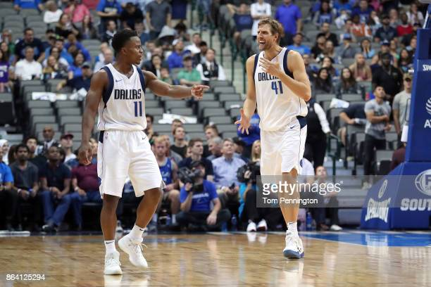 Dirk Nowitzki of the Dallas Mavericks and Yogi Ferrell of the Dallas Mavericks react to a call while taking on the Sacramento Kings in the second...