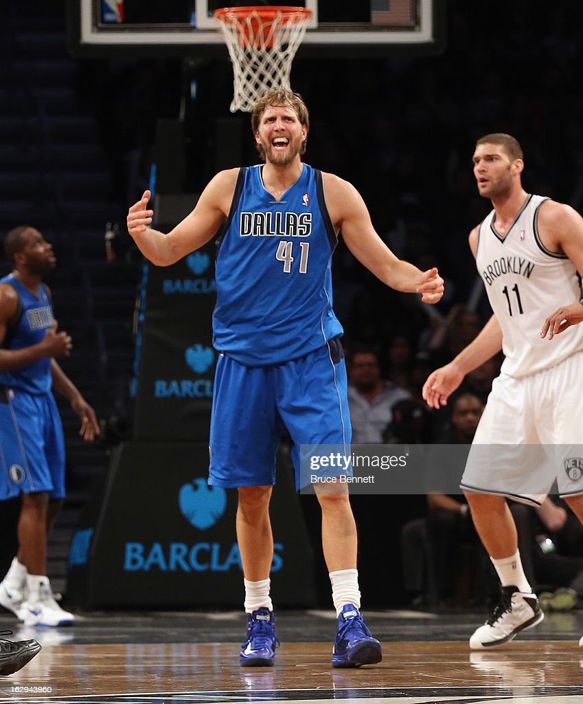 Dirk Nowitzki #41 of the Dallas Mavericks argues a call in the fourth quarter during the game against the Brooklyn Nets at the Barclays Center on March 1, 2013 in New York City.