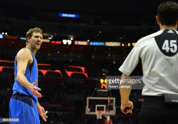 Dirk Nowitzki of the Dallas Mavericks argues with the referee during the game against the Los Angeles Clippers on April 5 2017 at STAPLES Center in...