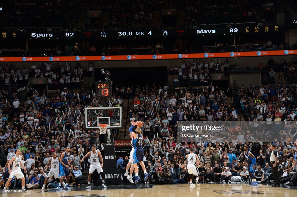 Dirk Nowitzki #41 of the Dallas Mavericks attempts the shot late in the game against the San Antonio Spurs on March 14, 2013 at the AT&T Center in San Antonio, Texas.