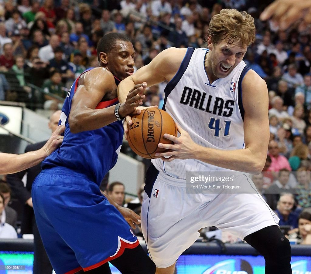 Dirk Nowitzki (41) of the Dallas Mavericks battles for the ball with Thaddeus Young (21) of the Philadelphia 76ers during the second period at the American Airlines Center in Dallas on Monday, Nov.18, 2013.