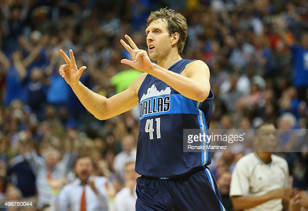 Dirk Nowitzki of the Dallas Mavericks celebrates a threepoint shot against the Los Angeles Clippers in the second half at American Airlines Center on...
