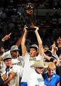Dirk Nowitzki of the Dallas Mavericks celebrates after winning the NBA Championship by defeating the Miami Heat during Game Six of the 2011 NBA...
