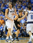 Dirk Nowitzki of the Dallas Mavericks celebrates during play against the San Antonio Spurs in Game Six of the Western Conference Quarterfinals during...