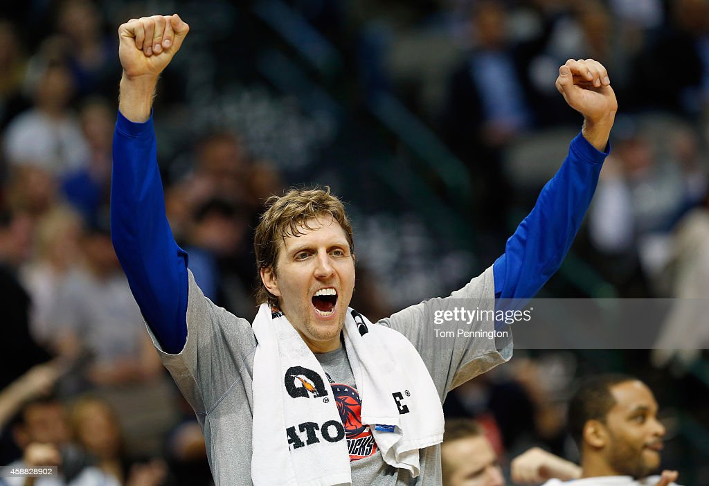 Dirk Nowitzki #41 of the Dallas Mavericks celebrates in the final seconds of the fourth quarter as the Mavericks beat the Sacramento Kings 106-98 at American Airlines Center on November 11, 2014 in Dallas, Texas. Dirk Nowitzki took over 9th place on the NBA's All-Time Scoring list in front of Hakeem Olajuwon against the Sacramento Kings on November 11, 2014 at the American Airlines Center in Dallas, Texas.