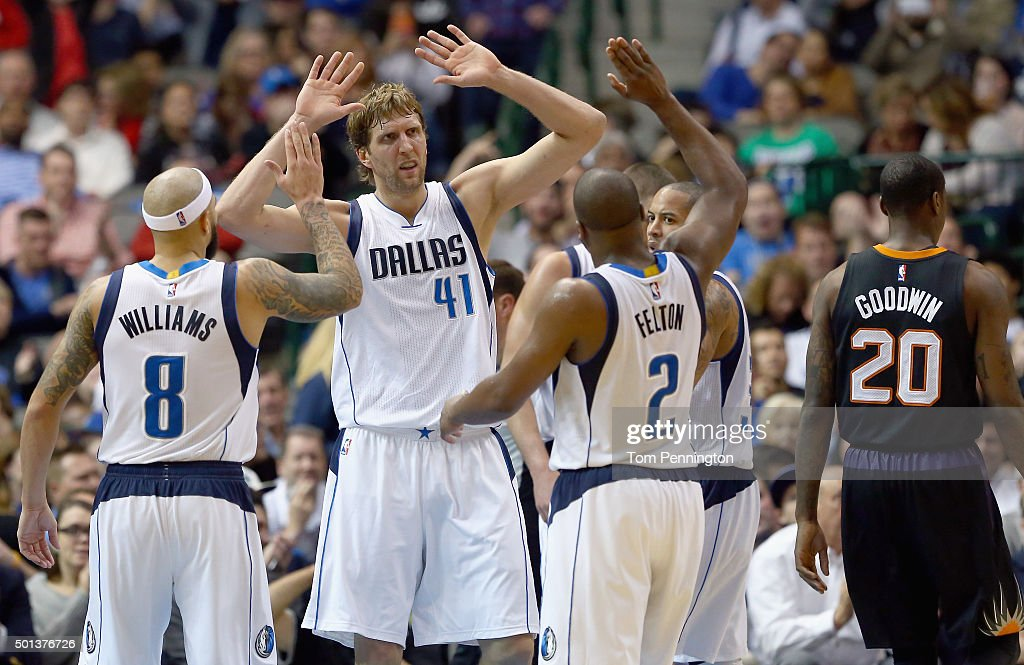 Dirk Nowitzki #41 of the Dallas Mavericks celebrates with Deron Williams #8 of the Dallas Mavericks and Raymond Felton #2 of the Dallas Mavericks in the second half against the Phoenix Suns at American Airlines Center on December 14, 2015 in Dallas, Texas.