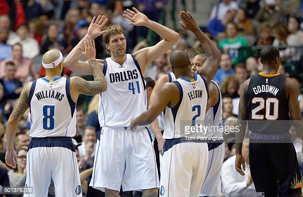 Dirk Nowitzki of the Dallas Mavericks celebrates with Deron Williams of the Dallas Mavericks and Raymond Felton of the Dallas Mavericks in the second...
