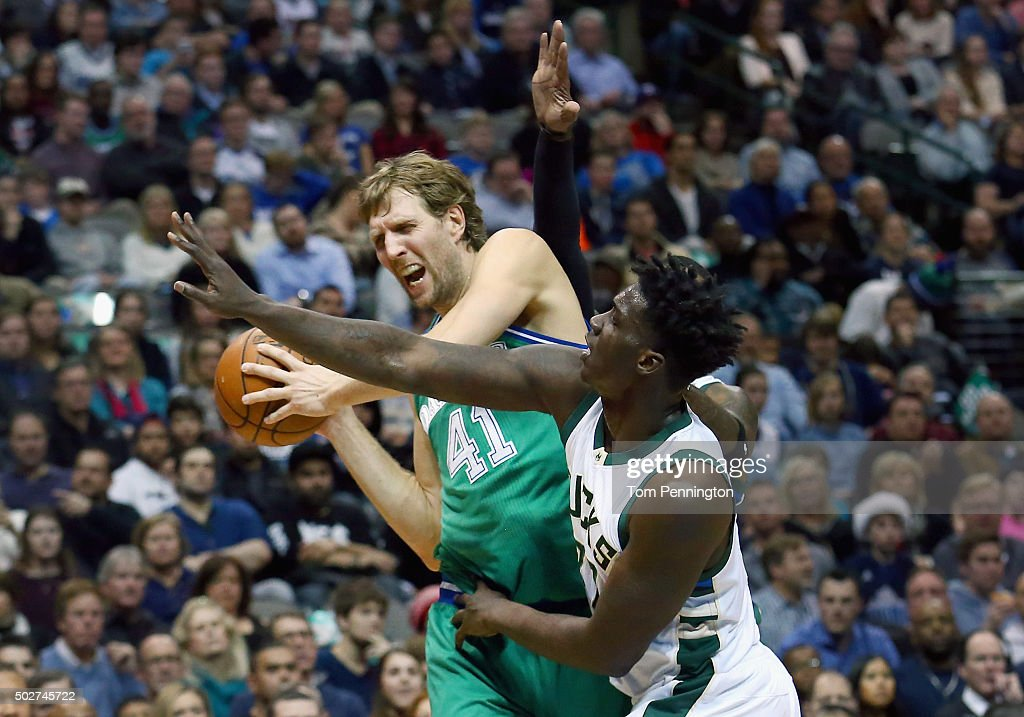 <a gi-track='captionPersonalityLinkClicked' href=/galleries/search?phrase=Dirk+Nowitzki&family=editorial&specificpeople=201490 ng-click='$event.stopPropagation()'>Dirk Nowitzki</a> #41 of the Dallas Mavericks controls the ball against <a gi-track='captionPersonalityLinkClicked' href=/galleries/search?phrase=Johnny+O%27Bryant+III&family=editorial&specificpeople=7621234 ng-click='$event.stopPropagation()'>Johnny O'Bryant III</a> #77 of the Milwaukee Bucks in the first half at American Airlines Center on December 28, 2015 in Dallas, Texas.
