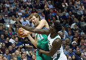 Dirk Nowitzki of the Dallas Mavericks controls the ball against Johnny O'Bryant III of the Milwaukee Bucks in the first half at American Airlines...