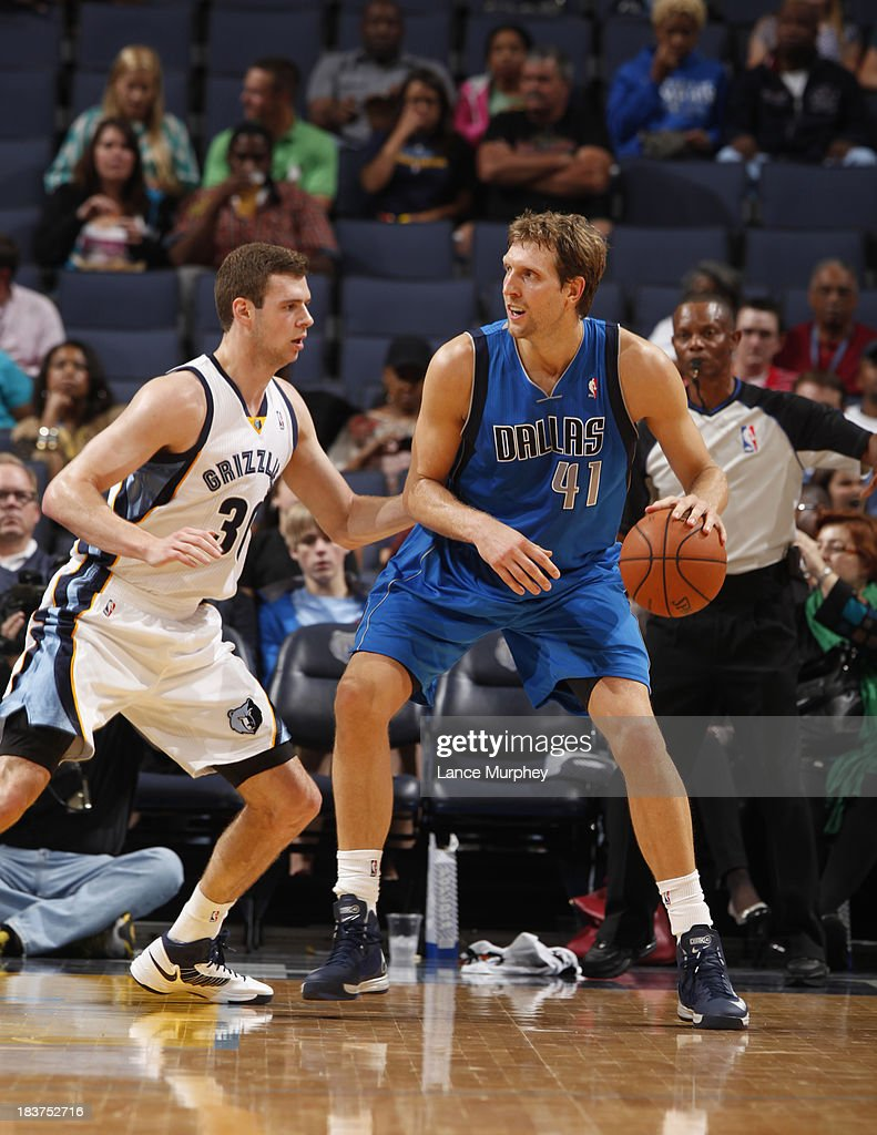 <a gi-track='captionPersonalityLinkClicked' href=/galleries/search?phrase=Dirk+Nowitzki&family=editorial&specificpeople=201490 ng-click='$event.stopPropagation()'>Dirk Nowitzki</a> #41 of the Dallas Mavericks controls the ball against John Leuer #30 of the Memphis Grizzlies during a game on October 9, 2013 at FedExForum in Memphis, Tennessee.