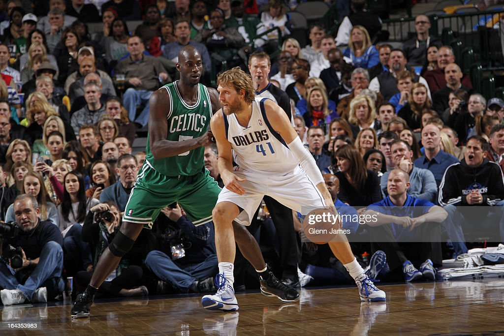 Dirk Nowitzki #41 of the Dallas Mavericks controls the ball against Kevin Garnett #5 of the Boston Celtics on March 22, 2013 at the American Airlines Center in Dallas, Texas.