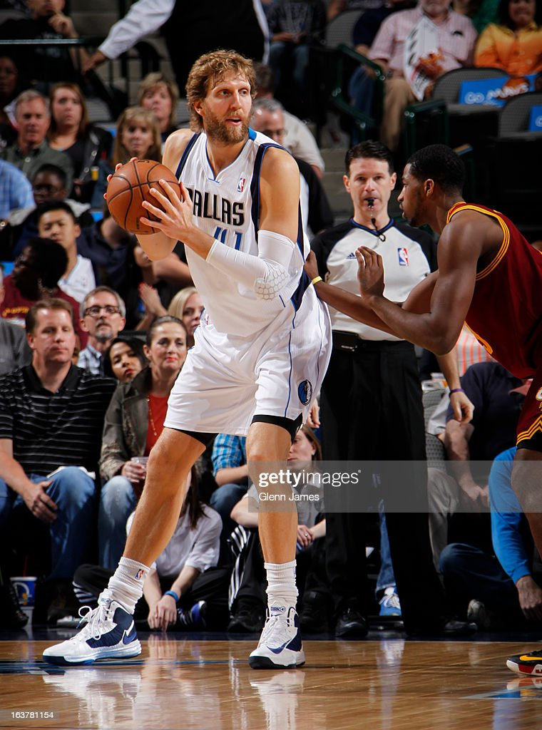 Dirk Nowitzki #41 of the Dallas Mavericks controls the ball against Tristan Thompson #13 of the Cleveland Cavaliers on March 15, 2013 at the American Airlines Center in Dallas, Texas.