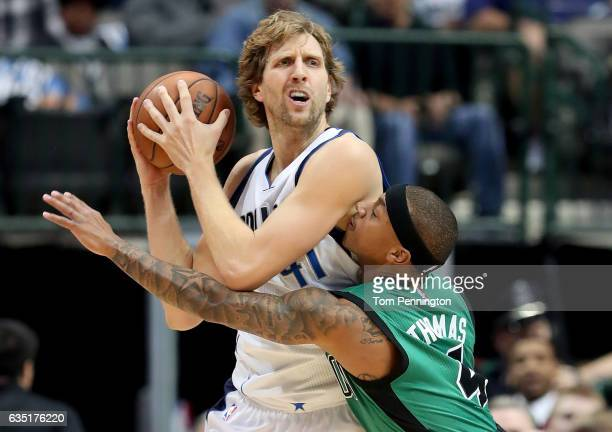 Dirk Nowitzki of the Dallas Mavericks controls the ball against Isaiah Thomas of the Boston Celtics in the first half at American Airlines Center on...
